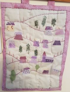 One of our lovely members Viv had chatted to Valerie at the West Country Quilt show in Bristol last year about Julia Gahagan's Miniature quilts. She was busy making this lovely alpine village pattern and was learning how to do it from Julia's video on our site. She was determined to finish it by Christmas - and she did.    She told us has really enjoyed making it and we agree with everyone who she has shown it to, that it is a very pretty piece of work - Very well done indeed Viv!!! Alpine Village, Country Quilts, Miniature Quilts, Mini Quilts, Show And Tell, Love Is All, Bristol, Miniatures, Houses