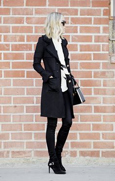 Jacey Duprie is wearing a knit coat from St. John Collection, coated leggings from Helmut Lang, bag from Prada, boots from Saint Laurent and the silk shirt is from Issa Dorris