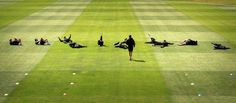 March 9, 2013: Members of the New Zealand cricket team stretch before the start of a training session at the University Oval in Dunedin.