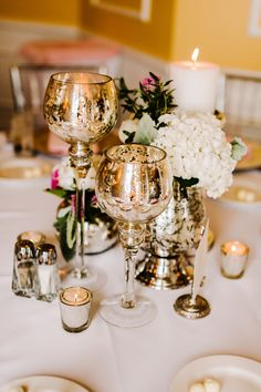 Mercury Glass Candles and Vases -- See the wedding on SMP: http://www.StyleMePretty.com/midwest-weddings/2014/03/07/bay-harbor-wedding/ Kai Heeringa Photography