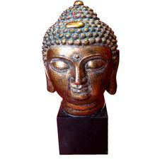 Antique gold Buddha head. £81.99  http://www.worldstores.co.uk/p/Buddha_Head_Antique_Gold.htm