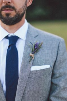 Wedding Suits An herbal boutonniere with lavender complements a gray suit so well for a summer wedding. - These boutonnieres are especially gorgeous for summer weddings. Groom Outfit, Groom Attire, Groom And Groomsmen, Groom Suits, Mens Suits, How To Dress For A Wedding, Perfect Wedding Dress, Wedding Men, Wedding Groom