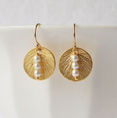 Dainty and petite earrings. Pretty pearl stack on gold tone disks Earrings measure from top to bottom: less than 1  -see additional photos Earrings
