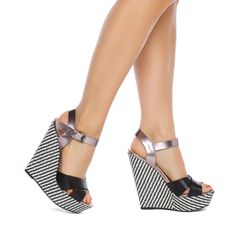 With mixed materials and modern embellishments, Ishah is a must for date-night chic. This ladylike platform by Madison features a structured woven wedge and blingy metallic accents.