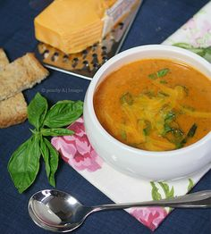 Meatless Tomato, Basil and Cheddar Soup Author: The Peach Kitchen  1can diced tomatoes 1onion, chopped 2 cloves garlic 1 t. olive oil 2 cups chicken broth 1 c. Greek yogurt 1 cup cheddar cheese, grated ½c. basil leaves, chopped, loosely packed 2 t. of oregano 1 t. sugar s & p  At the end, stir in the Greek yogurt and cheddar cheese until well blended. Use either an immersion blender or food processor to puree the soup.