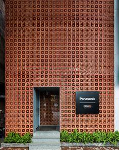vo trong nghia stacks terracotta brick façade for panasonic showroom