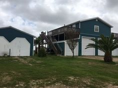 19 Dewberry Lane, Seadrift, Texas 77983. Wonderful two bedroom one bath home with private and separate one bedroom one bath mother-in-law suite attached with wrap around porchces!! This property is located in secluded Seaport Lakes subdivision, centrally located between Seadrift and Port O' Connor on a corner one acre lot. #homeforsale #seadrift #seadrifttx #seadrifttexas #calhouncounty #SeaportLakes #secluded #cornerlot #jacuzzitub #russellcainrealestate