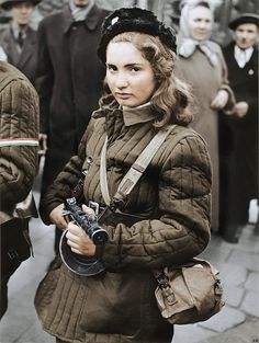 Young Hungarian girl during the Hungarian Revolution 1956. She is armed with a PPSH-41 and wears a Telogreika jacket by Za Rodinu on Flickr.