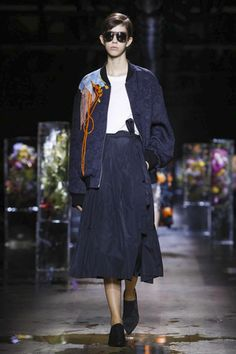 Slowly slowly, water flooded the Dries Van Noten catwalk. The culprit? Melting blocks of ice, parallelpiped with big bouquets of flowers magically trapped inside, for a setting that changed with ev...