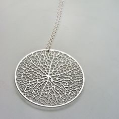 """Reticulate - """"The pattern was grown in our computer simulation of leaf venation and etched from a sheet of stainless steel."""" $50"""