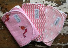 Baby Girl Burp Cloths - Set of 3 - Pink & White - Out to Sea in Playful Mermaid, Chevron, and Whales. $25.50, via Etsy.