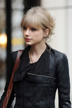 soft blunt bangs and leather jacket. Taylor Swift.