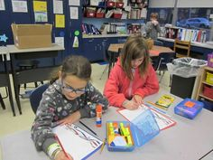 Fourth-graders at the Carrie E. Tompkins Elementary School write letters of thanks to servicemen and women.