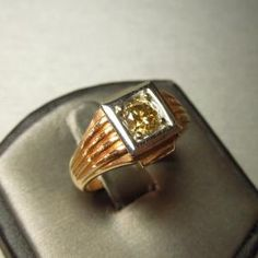 Vintage Man's 14kt Rose Gold Cognac Diamond Ring Circa 1940  Containing one Round Brilliant cut  Genuine Natural Cognac Diamond  weighing approximately .86 carats.  with SI2 Clarity  Ring Size 9 3/4 (can be sized) & weighs 11.5 grams       Item Number:   WS1300