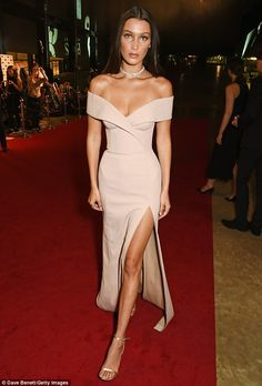 Go for gold: Bella Hadid, 19, stunned in a champagne-hued Bardot gown at the GQ Men of the Year Awards on Tuesday night