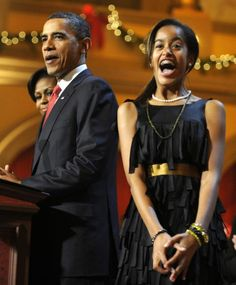 Someone's excited! This is the most animated I have ever seen Malia Obama in a photograph.