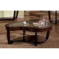 This would be really cool but of course way too expensive  @Overstock - Stylish coffee table will enhance your personal styleFurniture has lower shelf that provides excellent storage space for magazines, books, and remote controlsTable will make a wonderful addition to your home decorhttp://www.overstock.com/Home-Garden/Dark-Cherry-Glass-Coffee-Table/4333378/product.html?CID=214117 $320.99