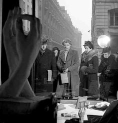 Vitrine rue du Faubourg Saint Honoré Pendant l'occupation by Robert Doisneau
