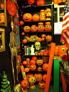 A delightful collection of vintage Halloween light-ups, candy containers, and decorations