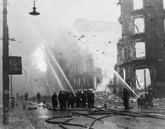"Firemen directing hoses on burning buildings in the city of Manchester ~ part of ""WAR OFFICE SECOND WORLD WAR OFFICIAL COLLECTION"""