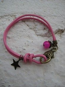 Pulsera rosa con estrella