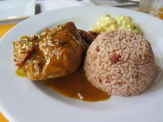 Are you interested in learning to make Belizean home cooked stew chicken with rice and beans? Grab the Belize recipe here and make the best rice & beans!