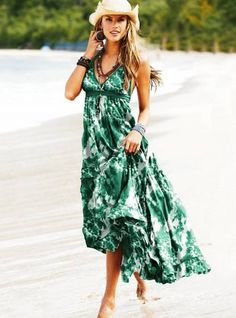 We love a long, bold printed maxi dress. So cute styled with a straw cowboy hat too!