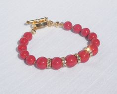Swarovski red coral pearl and gold bracelet by ParkhillDesigns on Etsy