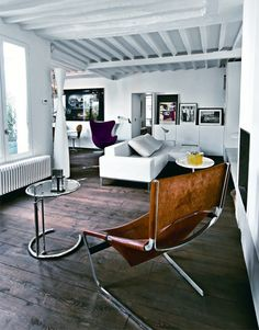 A rare sighting of the Pierre Paulin F444 Chair, here with old friends Eileen Gray adjustable table and Purple Egg Chair.
