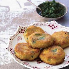 These delicate and slightly sweet fritters from Devi Garh palace-hotel are deliciously flecked with cilantro leaves and held together simply by the starch in the corn. A dusting of flour just before they're pan-fried gives them a light, crisp crust. For a richer flavor, cook the fritters in unsalted butter instead of vegetable oil.