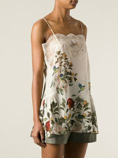 Silk floral cami top from Erika Cavallini Semi Couture featuring spaghetti straps, a lace panel, a floral print, an a-line style and side gathers