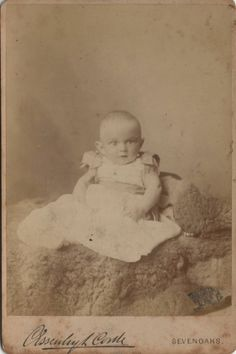 Cabinet photo of a Victorian Baby taken in Sevenoaks, Kent around 1890s by Essenhigh Corke at his studio located at 39 London Road.