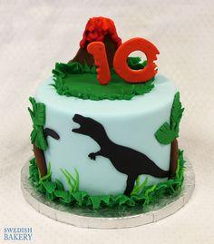 Dino Volcano | Single tier, fondant children's party cake with fondant dinosaur scene and volcano topper.