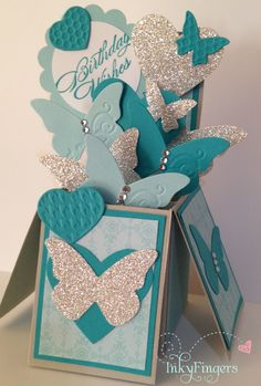 Stampin Up - Card in a box - using Beautiful Wings embosslits and heart punch - In bermunda bay, soft sky and silver glitter paper :)