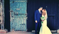Bride and groom outside the old stable door at Avoncroft Museum of Historic Buildings (avoncroft.org.uk). Rosie Kelly Photography