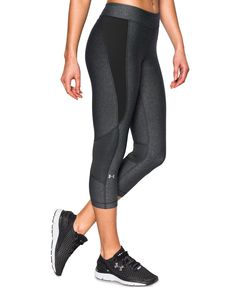 Under Armour combines lightweight HeatGear coverage that won't weigh you down with sleek, eye-catching style. | Polyester/elastane | Machine washable | Imported | Mid rise | Skinny fit through hips an