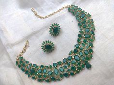 Mar 2020 - Green Necklace with Matching Stud Earrings ~ South India Jewels Indian Jewelry Earrings, Indian Jewelry Sets, Fancy Jewellery, Jewelry Design Earrings, Emerald Jewelry, Stud Earrings, Emerald Necklace, Jewlery, Gold Jewelry Simple