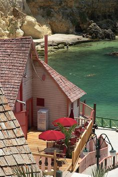 Houses on Popeye Village, Anchor Bay, Malta (by GeertVG).