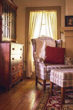 Love everything in this photo! The dresser /hutch, the chair / ottoman, floors etc!