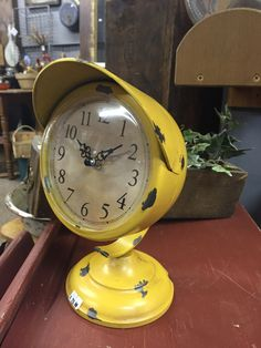 A headlight clock...perfect for the man cave! Found at Tattered & Worn.