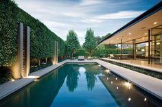 Toorak Residence in Australia Landscaped by Jack Merlo Design - I love the floor to ceiling glass and the way the roof 'floats'