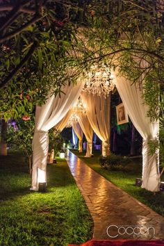 Outdoor path with columns draped and decorated with florals