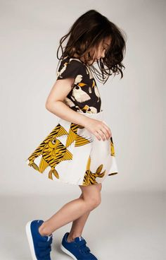 Fishes SweatSkirt cute and fun fish printed circle skirt in grey and yellow made from organic cotton. Has rib and elastic waist for perfect comfort. Super swirly silhouette for any summer day!  Composition: 95% Organic Cotton 5% Elastane. GOTS certified.