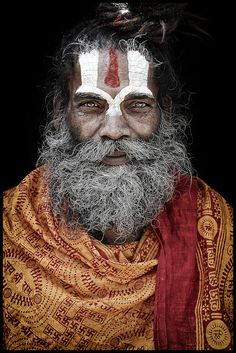 Faces covered in ash and paint, these are the Hindu holy men who live their lives away from everyday society. Known as sadhus, they shun all home comforts for a life of asceticism spent inside caves, forests and temples across India! Cultures Du Monde, World Cultures, We Are The World, People Around The World, Foto Picture, Beauty Around The World, Interesting Faces, Indian Art, Portrait Photography