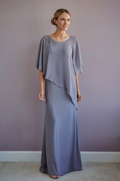 A soft romantic flare gown in Charlotte chiffon with a V-neckline, angel sleeves. Beading on one shoulder. Mother Of The Bride Dresses Long, Mother Of Bride Outfits, Mothers Dresses, Mob Dresses, Event Dresses, Bridesmaid Dresses, Wedding Dresses, Jasmine Bridal, Beautiful Evening Gowns
