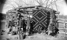Navajo winter hogan with Navajo Blanket over doorway circa 1880
