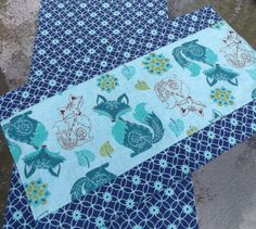 """Fancy Foxes in Teal, Aqua and Navy Extra Large Boutique Style Flannel Burp Cloth Set. Super soft flannel gives these large burp cloths a luxurious feel. Two full layers of superior quality flannel for extra absorbency and softness make a burp cloth that will last for years. These are not standard """"sew a strip of fabric on a generic cloth diaper"""" burp cloths. These cloths are completely handmade, and will last through washing after washing. Measuring at a very generous 12"""" x 20"""", they are..."""