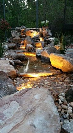A stroll in the garden...backyard waterfall and lighting idea