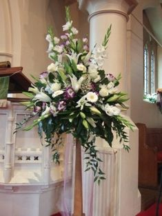 Image result for deep pink gerbera with ivory roses for church  wedding arrangement