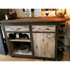 Transformed this vintage kitchen cabinet to a rolling buffet!  Reclaimed Wood added throughout and added vintage casters for charm and ease!  A B Inspired Designs One-Of-A-Kind !  http://www.binspireddesigns.net http://www.facebook.com/binspireddesigns